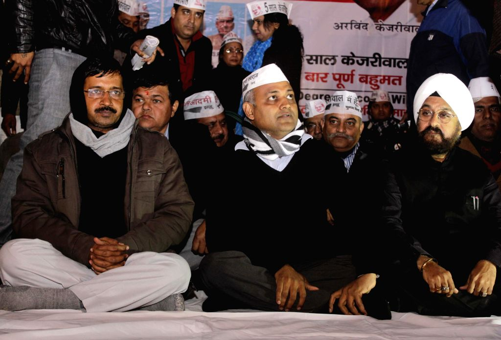 Aam Admi Party leaders Arvind Kejriwal, Somnath Bharti with others during election meeting in New Delhi on Jan. 24, 2015.