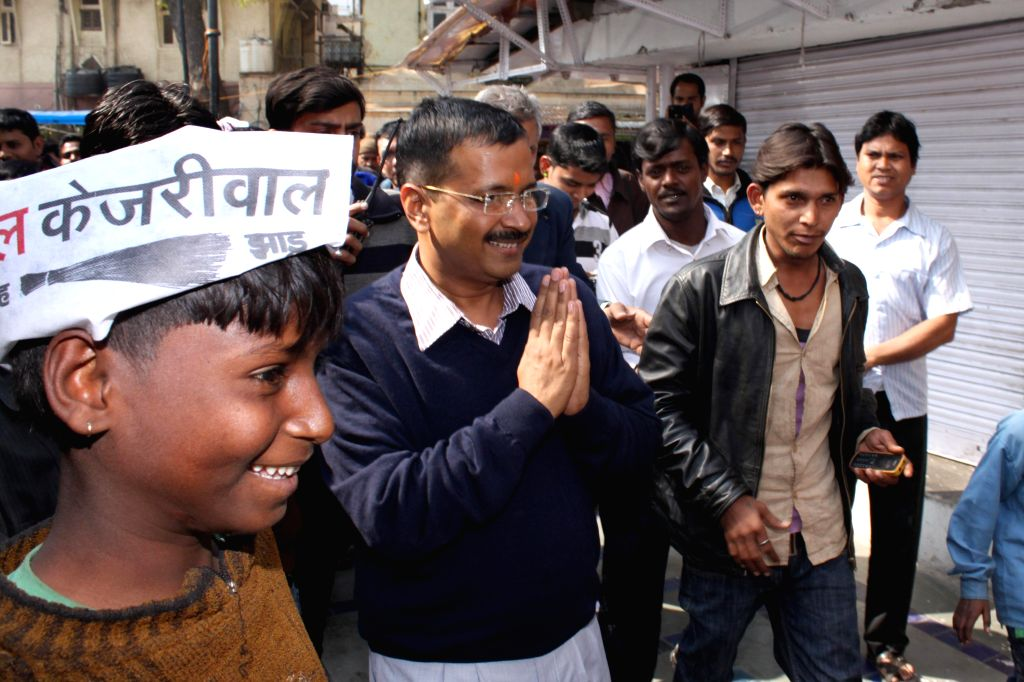 AAP leader Arvind Kejriwal during election campaign ahead of Delhi Assembly Polls at Hanuman Mandir, in Connaught Place,  New Delhi on Feb 6,2015.