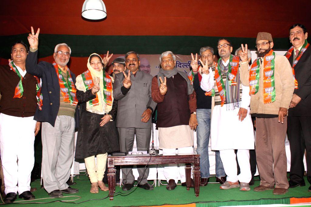 AAP leaders join BJP in presence of Delhi BJP chief Satish Upadhyay in New Delhi, on Jan 15, 2015.