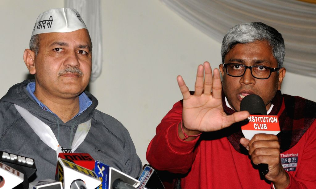 AAP leaders Manish Sisodia and Ashutosh during a press conference  in New Delhi, on Jan 15, 2015.