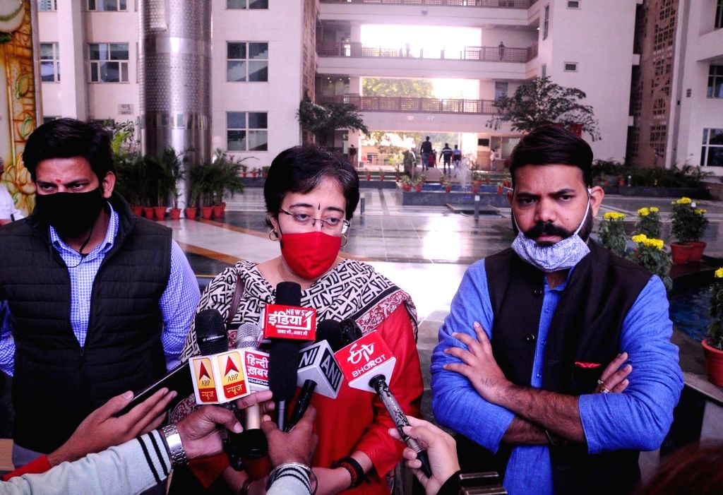 New Delhi: AAP MLA from Kalkaji & a member of the Political Affairs Committee of the Aam Aadmi Party Atishi Marlena accompanied by two other members, talks to the media after meeting the Chairperson of the Air Quality Commision over the issue of stub