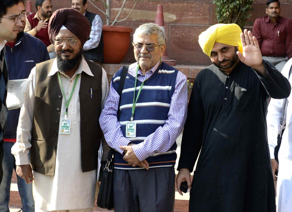 AAP MP Bhagwant Mann and other MPs at the Parliament premises in New Delhi, on Nov 25, 2014.