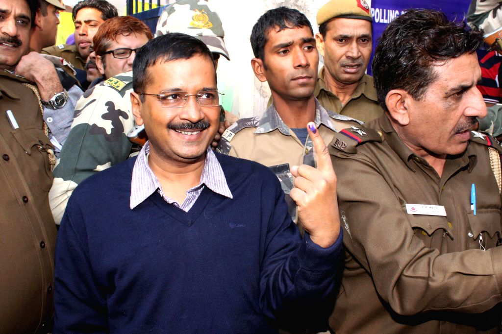 AAP`s Chief Arvind Kejriwal after cast his vote at SGTB Khalsa, polling booth in New Delhi on Feb 07, 2015.