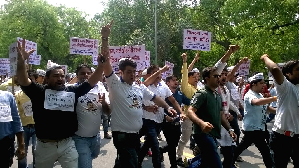 AAP workers stage a demonstration against External Affairs Minister Sushma Swaraj in New Delhi on June 20, 2015.