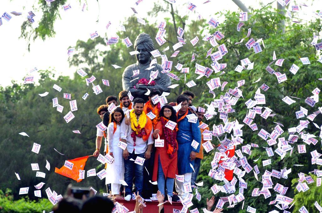 New Delhi: ABVP (RSS-affiliated students organisation) candidates Akshit Dhaiya, Pradeep Tanwar and Shivangi Khaewal celebrate after winning the posts of Delhi University Students Union (DUSU) President, Vice President and Joint Secretary respectivel