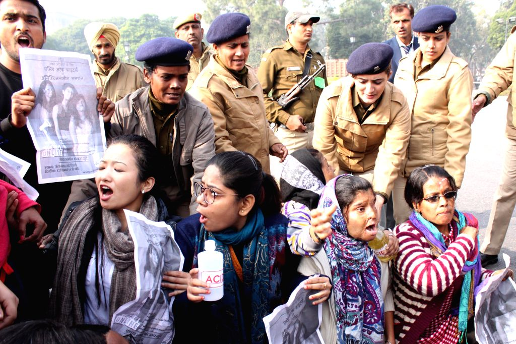 Acid attack survivors stage a demonstration outside Parliament, in New Delhi, on Dec 18, 2014.