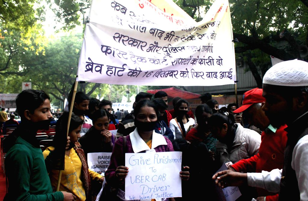 Activists demonstrate against Uber taxi rape case and 2012 Nirbhaya gangrape at Jantar Mantar in New Delhi on Dec 16, 2014.