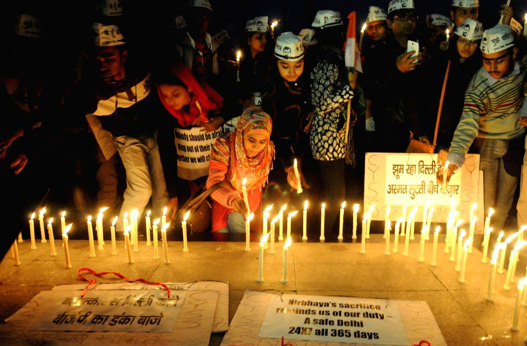 Activists of  Chhatra Yuva Sangharsh Samiti participate in a candlelight vigil to condemn the 2012 Nirbhaya gangrape in New Delhi, on Dec 16, 2014.