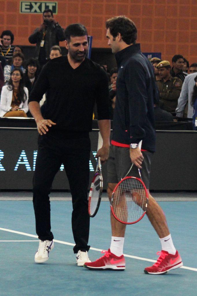 Actor Akshay Kumar with Indian Aces player Roger Federer during an IPTL match at Indira Gandhi Indoor Arena in New Delhi, on Dec 8, 2014.