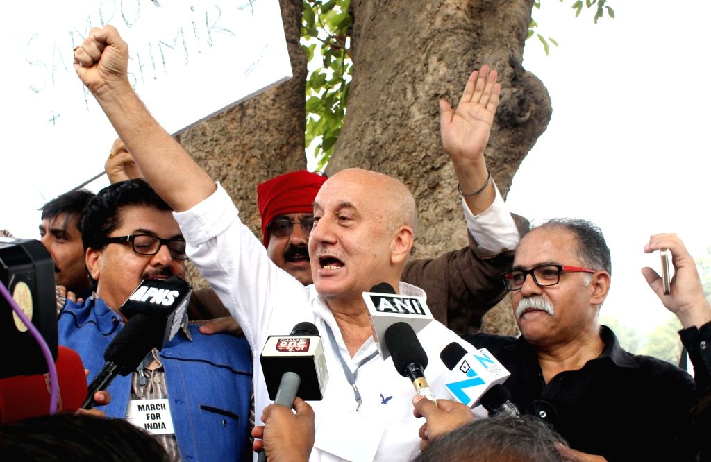 : New Delhi: Actor Anupam Kher leads `March For India` from India Gate to Rashtrapati Bhavan to protest against `intolerance` in the country in New Delhi on Nov. 7, 2015. (Photo: IANS). - Pranab Mukherjee