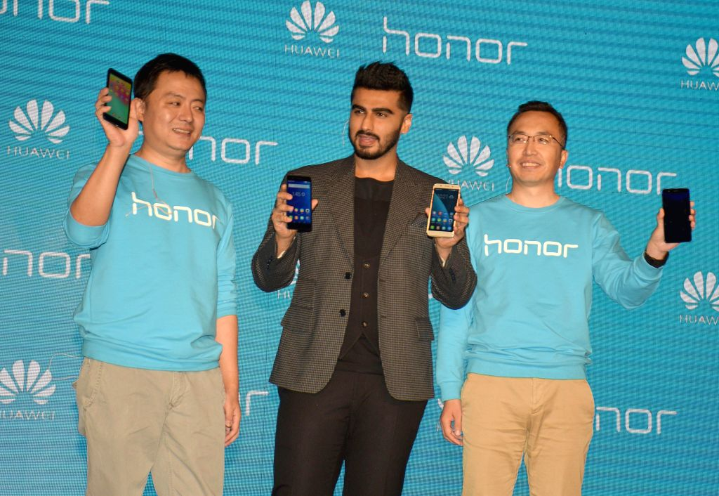 Actor Arjun Kapoor with Honor Mobiles president George Zhao and company official Allen Wang at the launch of  Honor 6 Plus and 4X in New Delhi on March 24, 2015.