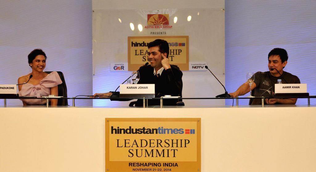 Actors Aamir Khan and Deepika Padukone with Director and Producer Karan Johar at the Hindustan Times Leadership Summit in New Delhi on Nov. 21, 2014. - Aamir Khan, Deepika Padukone and Karan Johar