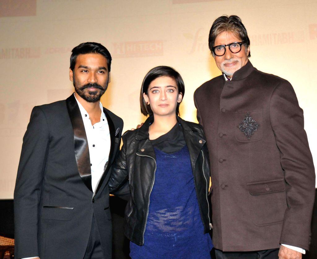 Actors Dhanush, Akshara Haasan and Amitabh Bachchan during a promotional event of their upcoming film `Shamitabh` in New Delhi on Feb. 2, 2015. - Dhanush, Akshara Haasan and Amitabh Bachchan