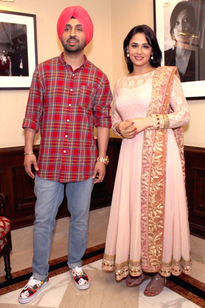 Actors Diljit Dosanjh and Mandy Takhar during a press conference of their upcomming film ``Sardaar Ji`` in New Delhi on June 19, 2015. - Diljit Dosanjh and Mandy Takhar