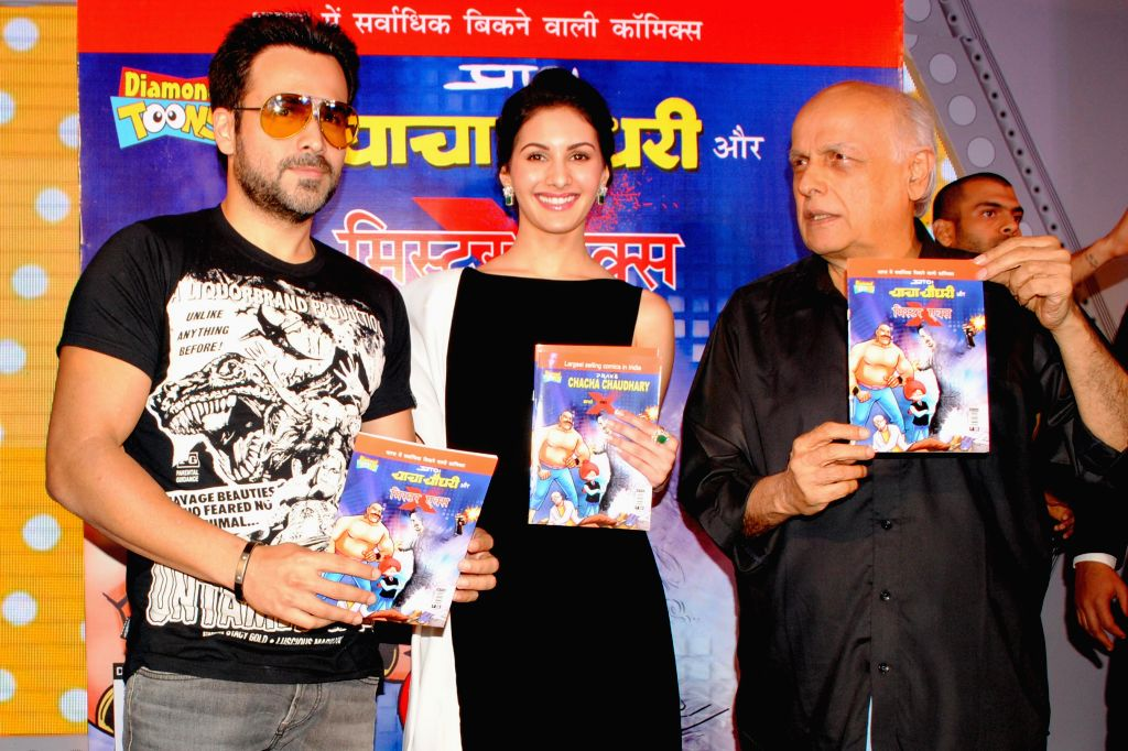 Actors Emraan Hashmi, Amyra Dastur with filmmaker Mahesh Bhatt during the promotion of their upcoming film ``Mr. X`` in New Delhi on April 4, 2015.