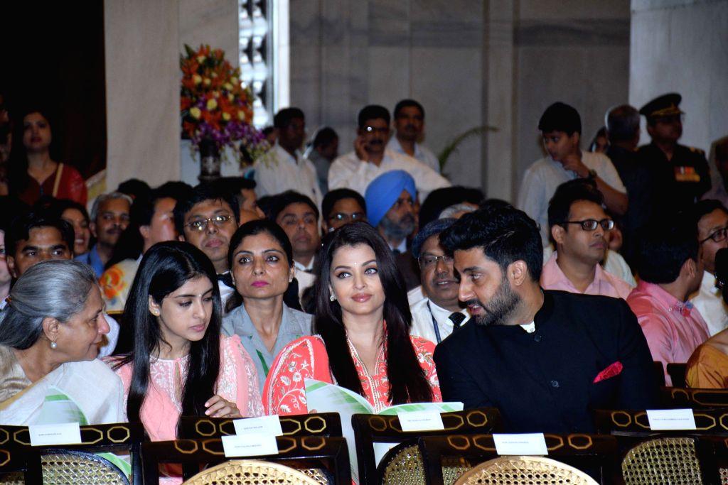 Actors Jaya Bachchan, Abhishek Bachchan and Aishwarya Rai Bachchan during a Civil Investiture Ceremony organised at the Rashtrapati Bhavan where Amitabh Bachchan was conferred Padma ... - Jaya Bachchan, Abhishek Bachchan, Aishwarya Rai Bachchan and Amitabh Bachchan
