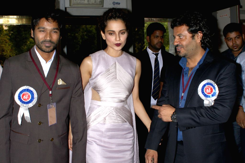 Actors Kangna Ranaut and Dhanush at the 62nd National Film Awards ceremony organised at Vigyan Bhavan in New Delhi, on May 3, 2015. - Kangna Ranaut and Dhanush