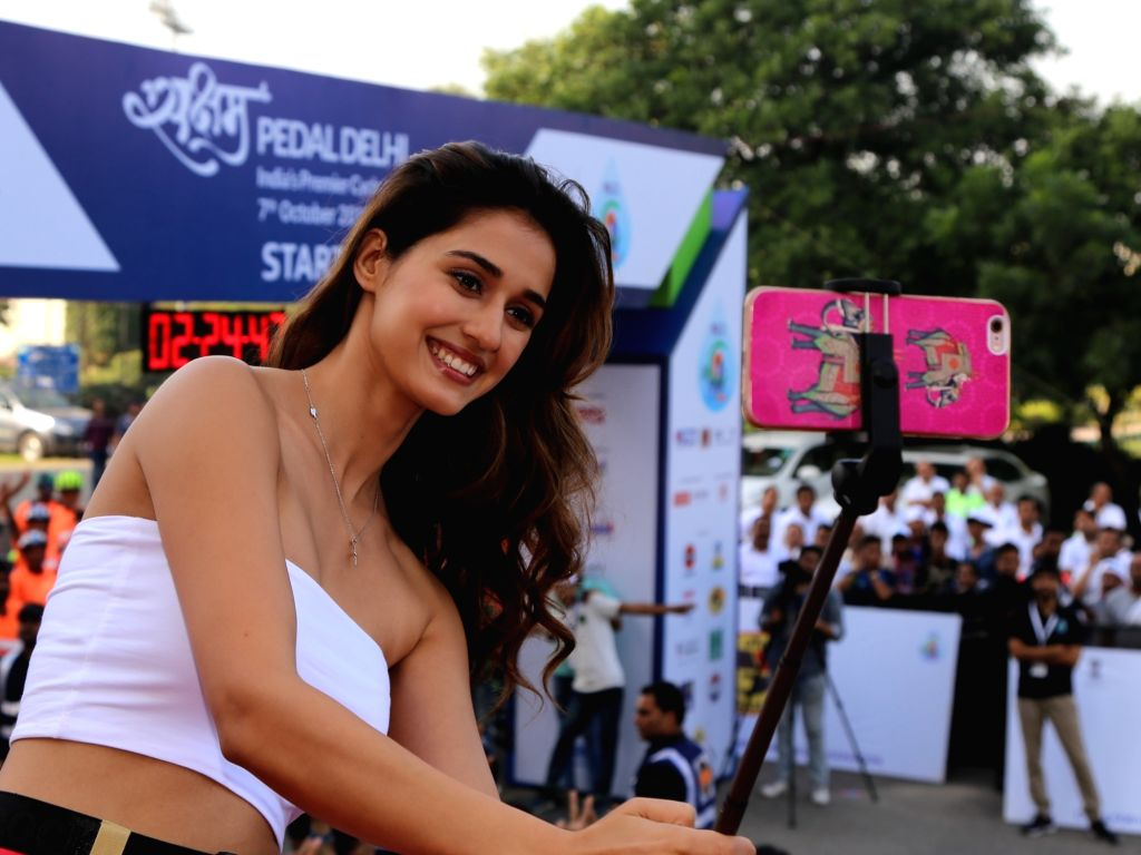 """:New Delhi: Actress Disha Patani poses for a selfie at the flagging off ceremony of second edition of """"Saksham Pedal Delhi"""" - India's premier cyclothon, in New Delhi on Oct 7, 2018. (Photo: ..."""