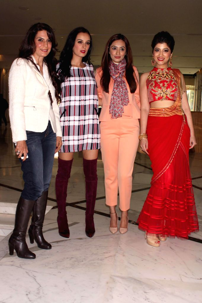 Actress Evelyn Sharma with Mallika during the 'Fashion Capsule - Grande 2015' in New Delhi on Jan 16, 2015. - Evelyn Sharma
