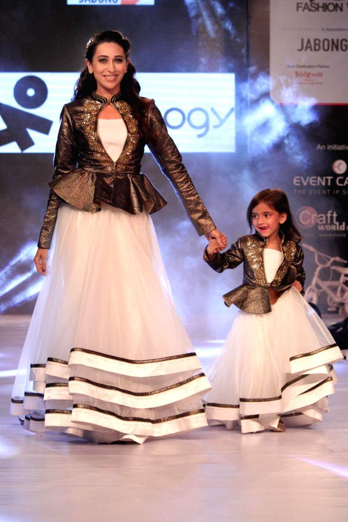 Actress Karisma Kapoor walks the ramp during the India Kids Fashion Week 2015 in New Delhi, on Feb 28, 2015.
