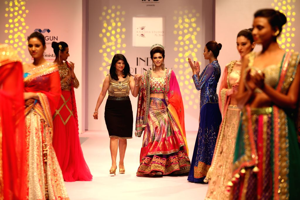 Actress Madhurima Tuli walks the ramp to showcase fashion designer Shalini Gupta's creations during the Day -2 of India Runway Week in New Delhi, on April 12, 2015. - Shalini Gupta