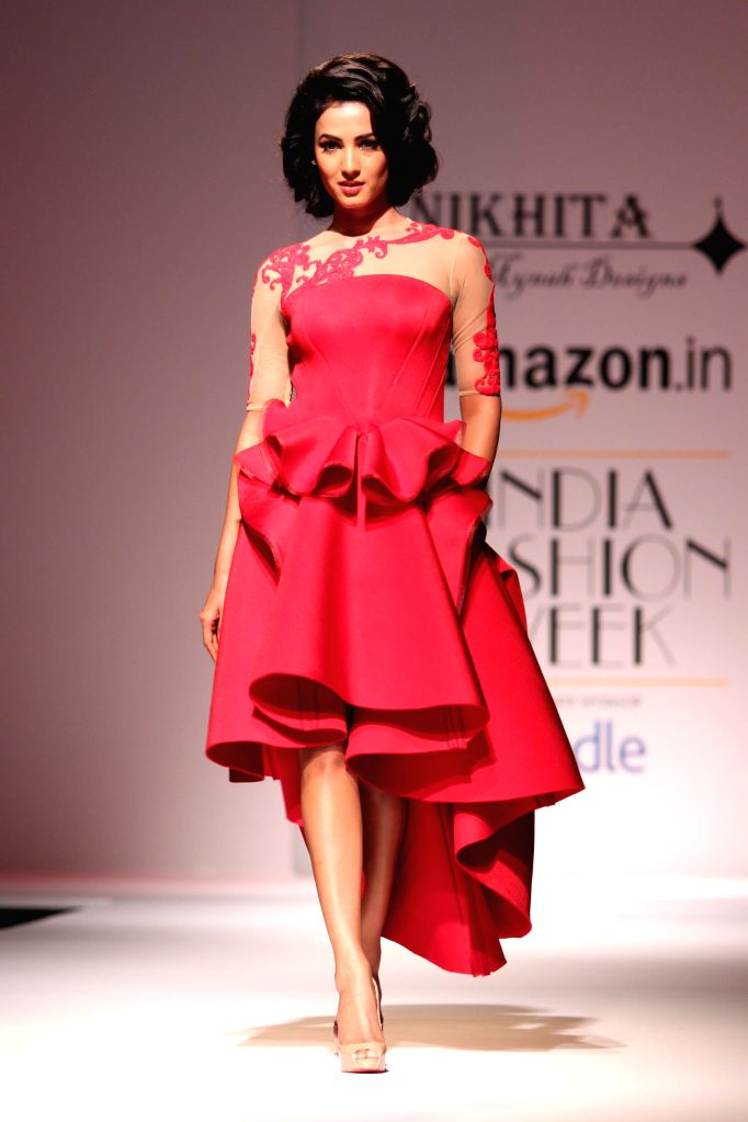 Actress Sonal Chauhan showcases fashion designer Nikhita Tandon`s creations during Amazon India Fashion Week in New Delhi, on March 28, 2015. - Sonal Chauhan