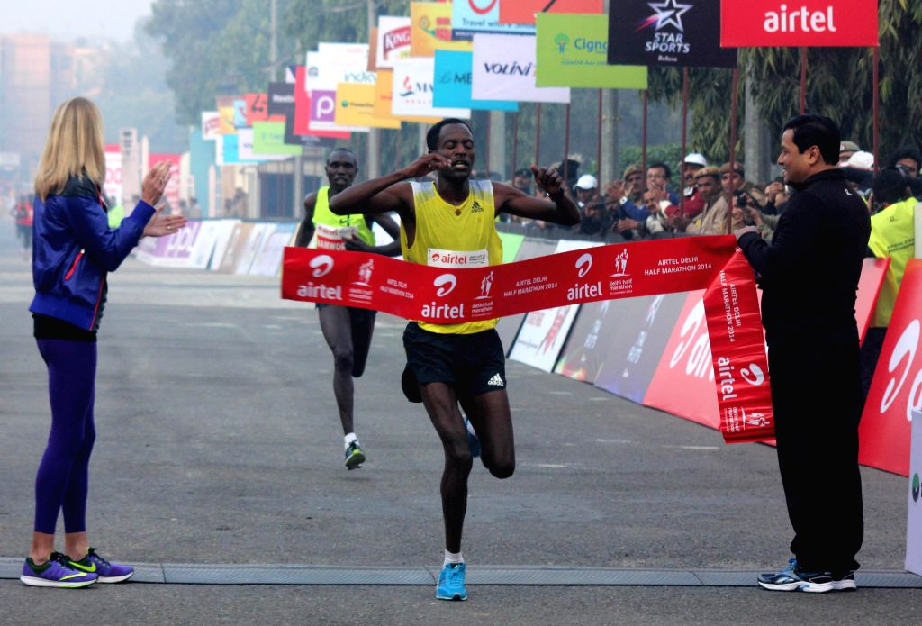 Adohala, a track and field athlete who set a new course record during Airtel Delhi Half Marathon at Jawaharlal Nehru Stadium in New Delhi on Nov 23, 2014.