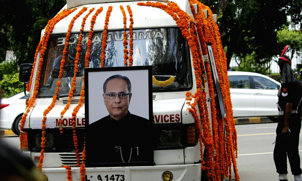 New Delhi: An ambulance leaves for the Lodhi Road Crematorium with the mortal remains of Former President Pranab Mukherjee from his 10 Rajaji Marg residence ahead of his funeral in New Delhi on Sep 1, 2020. Mukherjee passed away on Monday evening at  - Pranab Mukherjee