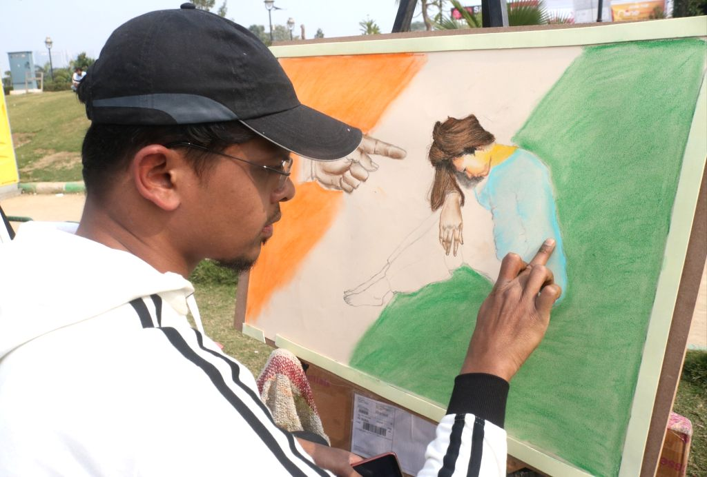 """New Delhi: An artist during """"Menstrual Health and Awareness Day"""" programme organised by Delhi government in New Delhi, on Feb 5, 2019. (Photo: IANS)"""
