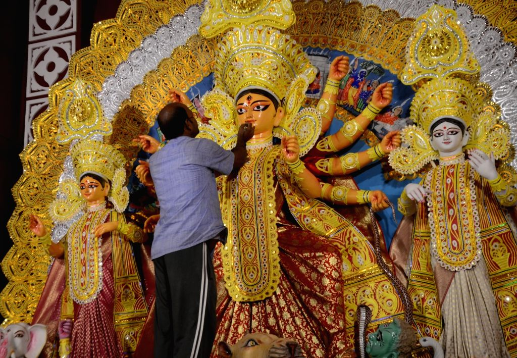 New Delhi: An artist gives finishing touches to an idol of Goddess Durga at a community puja pandal ahead of Durga Puja celebrations in New Delhi on Oct 20, 2020. (Photo: IANS)