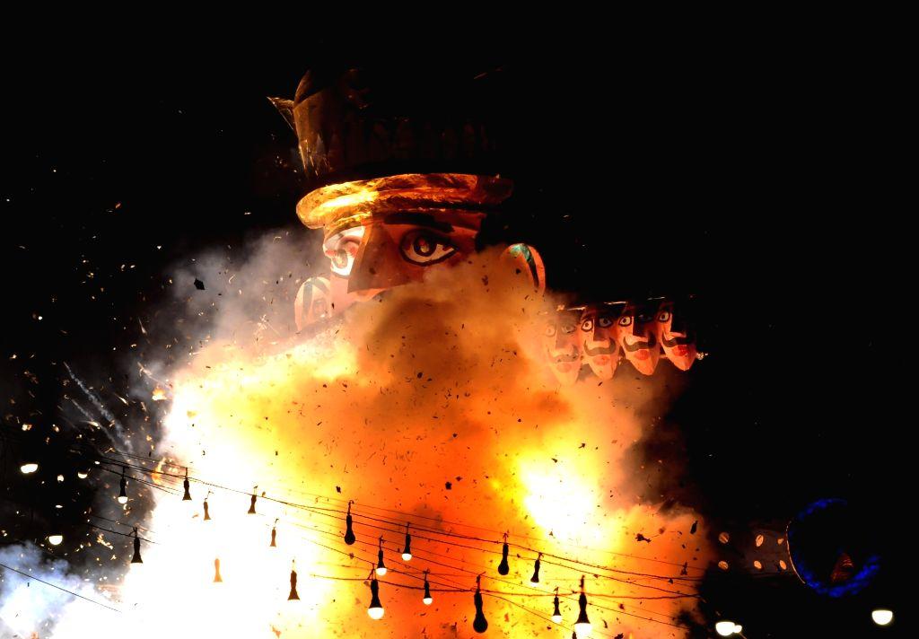 New Delhi: An effigy of Ravana being burnt on 'Vijaya Dashmi' at Ramlila Maidan in New Delhi on Oct 19, 2018. (Photo: IANS)