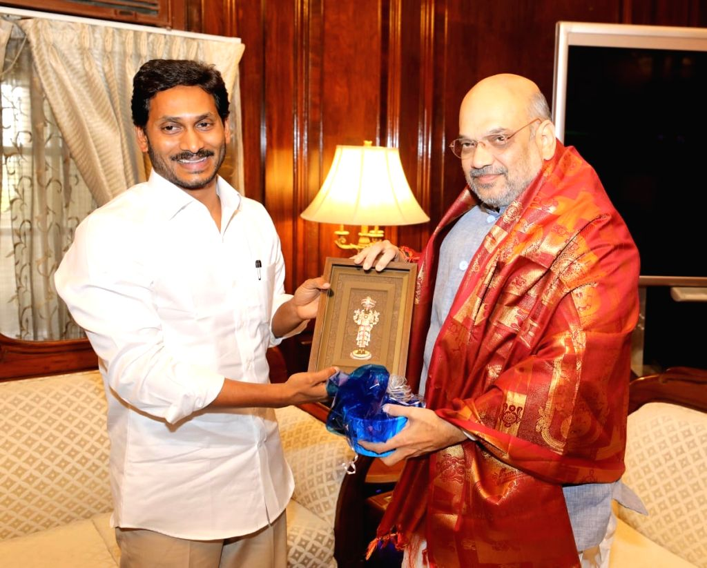 New Delhi: Andhra Pradesh Chief Minister Y.S. Jagan Mohan Reddy meets Union Home Minister Amit Shah, in New Delhi on June 14, 2019. (Photo: IANS) - Y. and Amit Shah