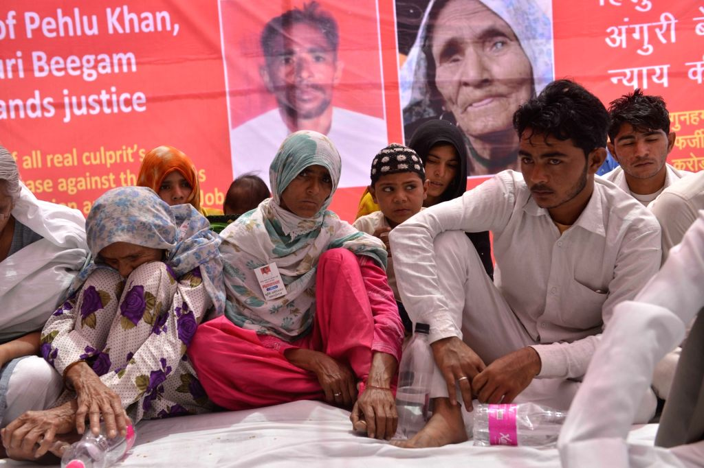 New Delhi: Anguri Begum, mother of dairy farmer Pehlu Khan along with her family members stage a sit-in demonstration to demand justice for him in New Delhi, on April 19, 2017. (Photo: IANS) - Pehlu Khan