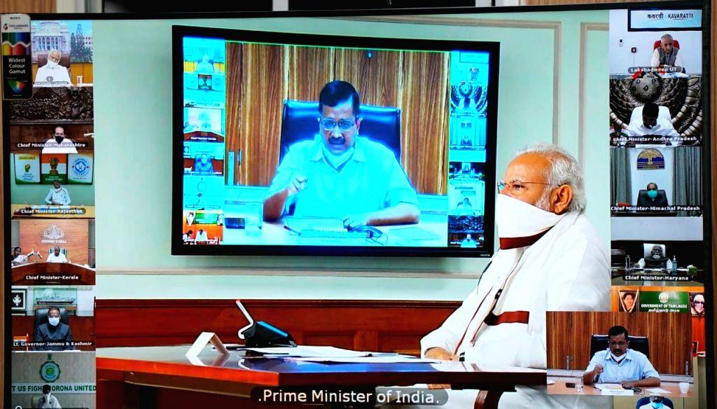 New Delhi, April 11 (IANS) Delhi Cheif Minister Arvind Kejriwal on Saturday hailed Prime Minister Narendra Modi's decision to extend the lockdown beyond April 14.(File Photo: IANS) - Arvind Kejriwal and Narendra Modi