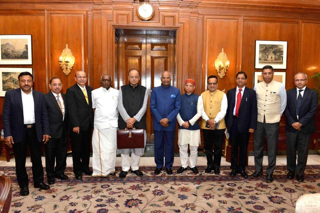 :New Delhi: Arun Jaitley, Union Minister of Finance meeting President Ram Nath Kovind before presenting the Budget 2018-19 at Rashtrapati Bhavan on Feb. 1, 2018. Also seen Pratap Shukla, MOS ...