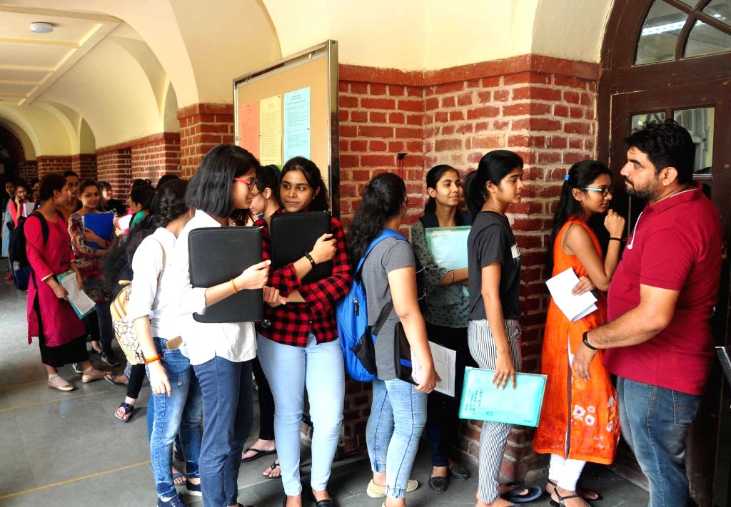 New Delhi: Aspirants queue up at Delhi University's Shri Ram College of Commerce for admissions after DU colleges released their first cut-off list for admissions to the university's undergraduate courses for the academic year, in New Delh