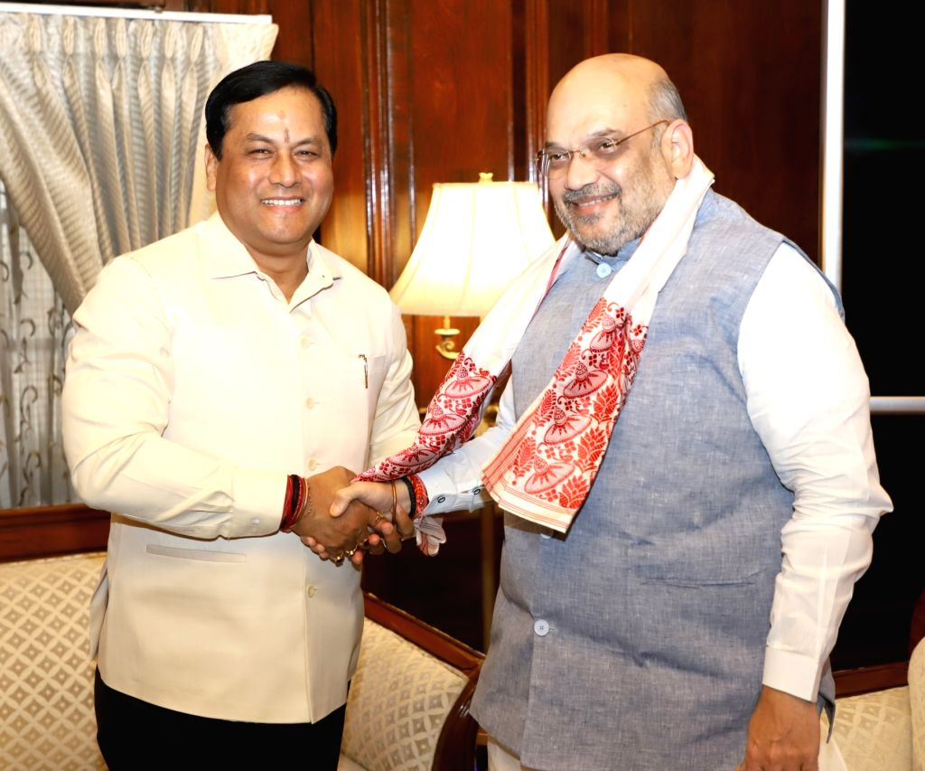 New Delhi: Assam Chief Minister Sarbananda Sonowal meets Union Home Minister Amit Shah, in New Delhi on June 14, 2019. (Photo: IANS/PIB) - Sarbananda Sonowal and Amit Shah