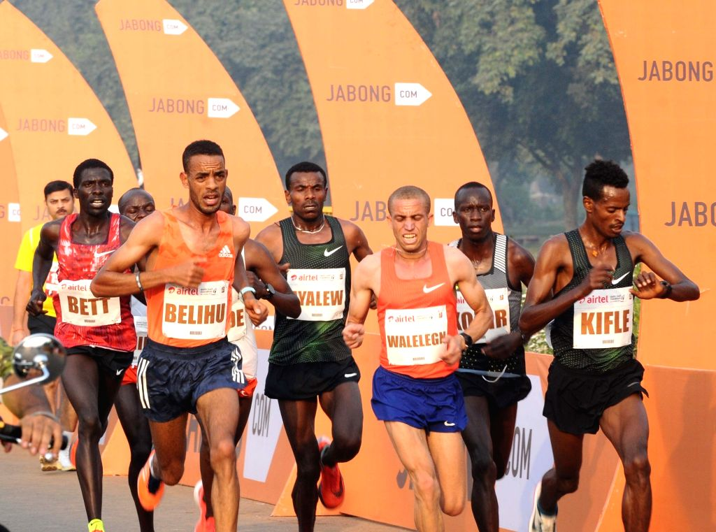 :New Delhi: Athletes participate in the 2018 Delhi Half Marathon, on Oct 21, 2018. Ethiopia ruled the roost at the marathon on Sunday with Tsehay Gemechu setting a new course record on her way to ...