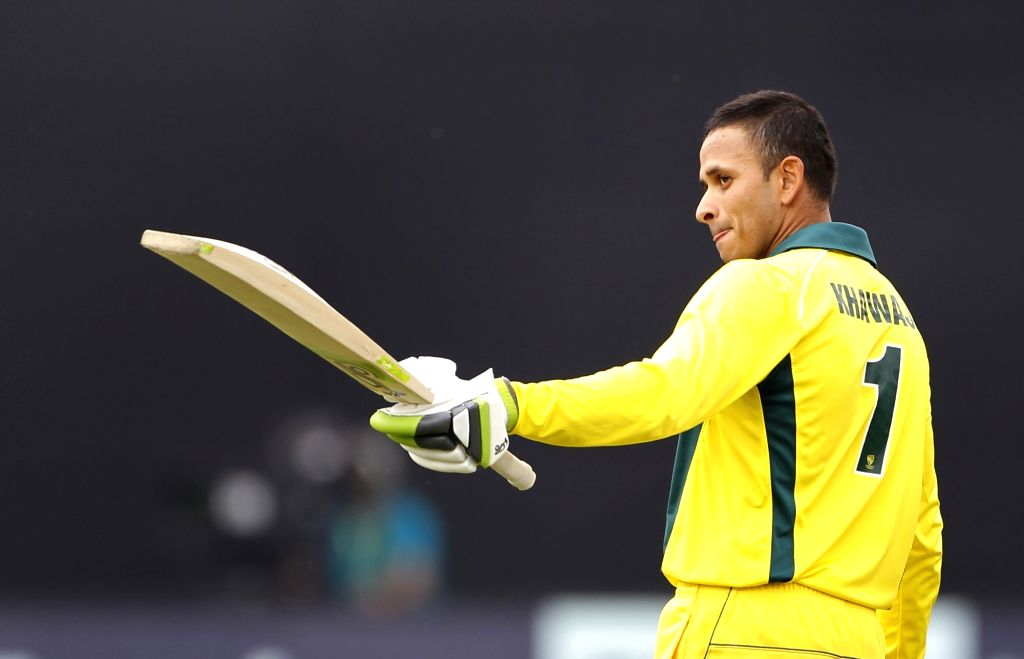 New Delhi: Australia's Usman Khawaja celebrates his century during the fifth ODI match between India and Australia at Feroz Shah Kotla Stadium, in New Delhi, on March 13, 2019. (Photo: Surjeet Yadav/IANS) - Surjeet Yadav