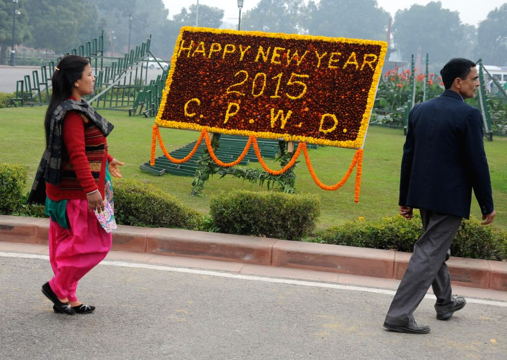 Authorities set up new year greetings at different places in New Delhi, on Jan 1, 2015.