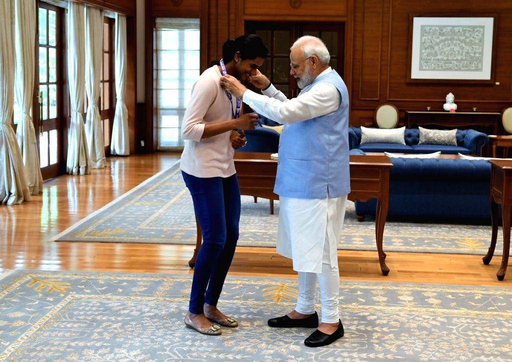 New Delhi: Badminton world champion PV Sindhu calls on Prime Minister Narendra Modi in New Delhi, on Aug 27, 2019. (Photo: IANS) - Narendra Modi