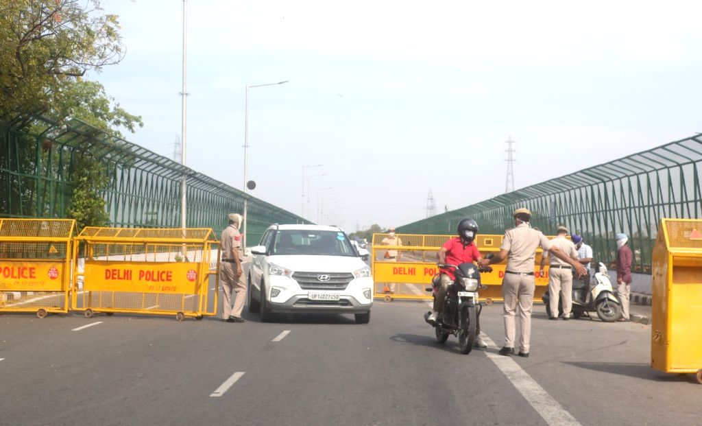 New Delhi: Barricades placed and police personnel deployed at ITO Bridge over Yamuna river, during the 21-day long nationwide lockdown imposed to contain the spread of COVID-19 (coronavirus), in New Delhi on March 25, 2020. (Photo: IANS)