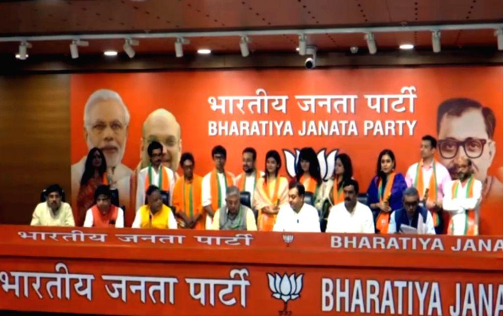 New Delhi: Bengali actors, Rishi Kaushik, Kanchana Moitra, Rupanjana Mitra and Biswajit Ganguly and Parno Mittra join the Bharatiya Janata Party (BJP) in the presence of BJP West Bengal chief Dilip Ghosh, Mukul Roy and spokesperson Sambit Patra at BJ - Dilip Ghosh and Mukul Roy