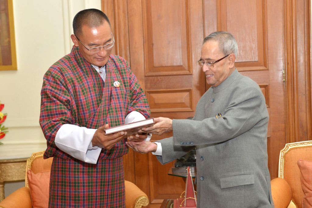 Bhutanese Prime Minister Tshering Tobgay calls on President Pranab Mukherjee at Rashtrapati Bhavan in New Delhi, on Jan 14, 2015. - Tshering Tobgay and Pranab Mukherjee