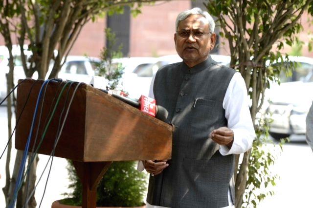 Bihar Chief Minister Nitish Kumar addresses press after meeting Prime Minister Narendra Modi in New Delhi, on March 26, 2015. - Narendra Modi