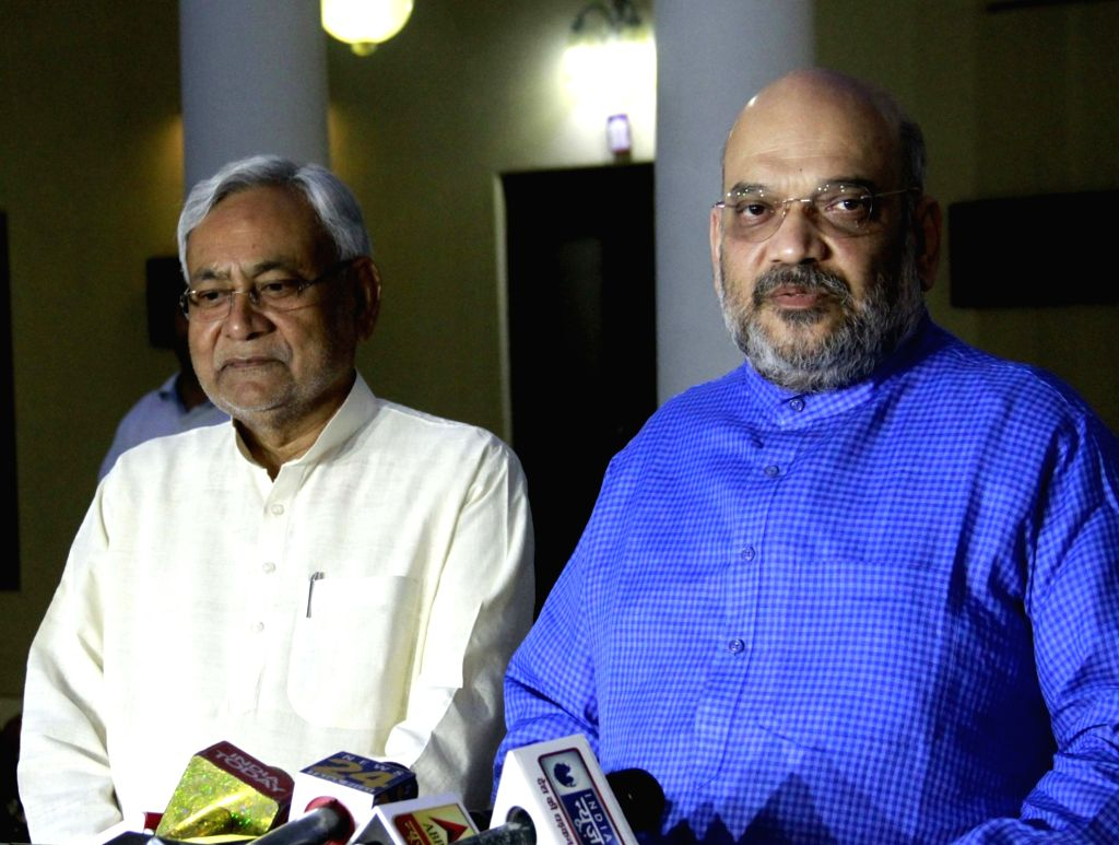 : New Delhi: Bihar Chief Minister Nitish Kumar and BJP chief Amit Shah addresse a press conference in New Delhi on Oct 26, 2018. (Photo: IANS).
