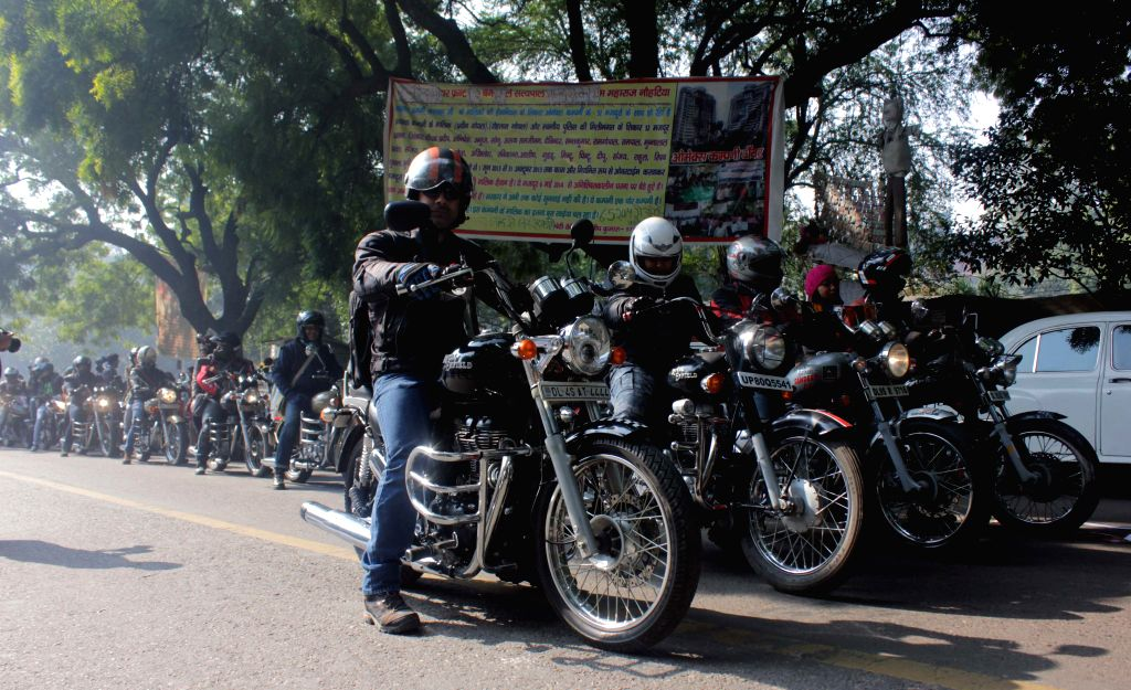 Bikers participate in a rally to urge people to give food instead of money to beggars in New Delhi, on Jan 18, 2015.