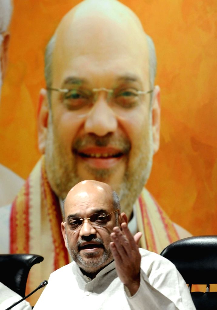 : New Delhi: BJP chief Amit Shah addresses a press conference, at the party's headquarter in New Delhi on May 21, 2018. (Photo: IANS).