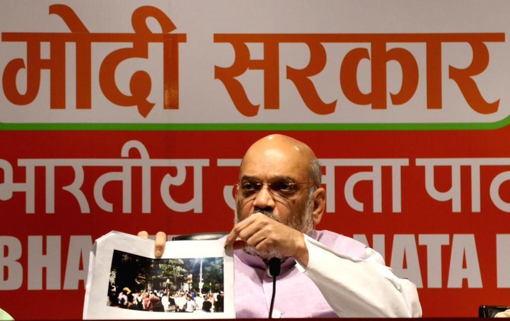 New Delhi:  BJP chief Amit Shah addresses a press conference in New Delhi, on May 15, 2019. (Photo: IANS) - Amit Shah