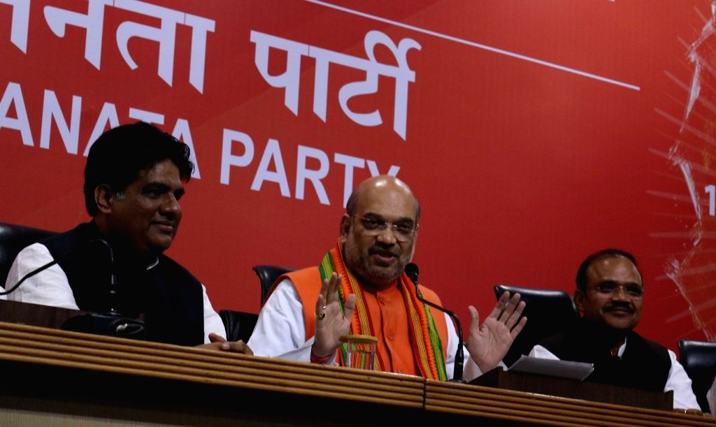 : New Delhi: BJP chief Amit Shah addresses a press conference regarding party's performance in the assembly elections in New Delhi on March 11, 2017. (Photo: IANS).
